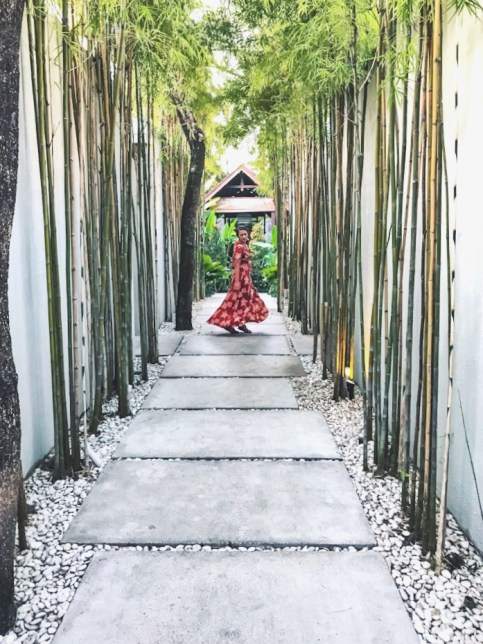 Lauryn walking down the pathway at The Amala resort