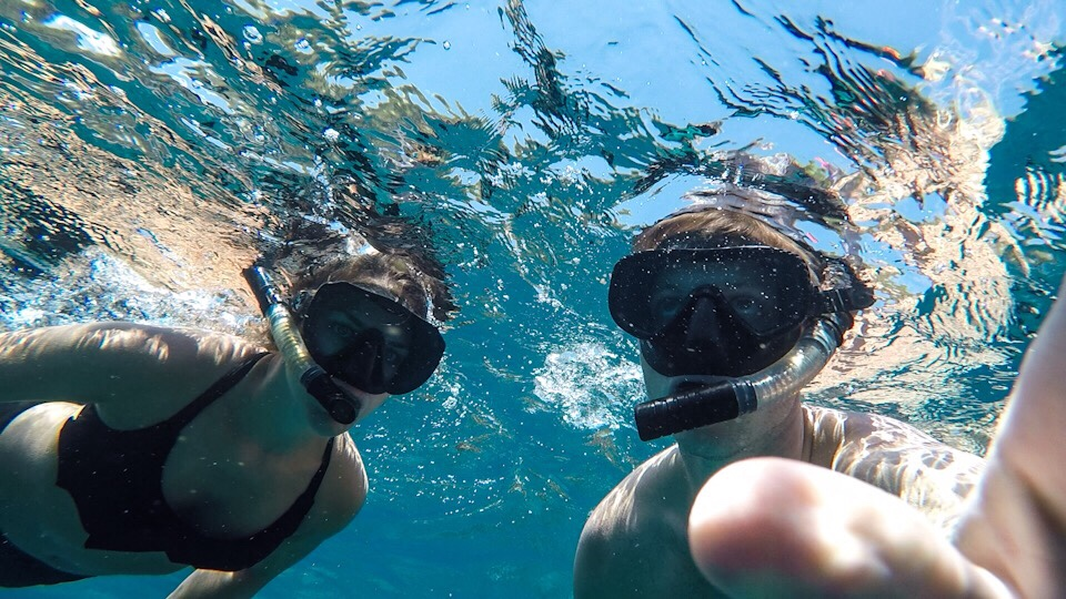 Lauryn and Eric snorkeling at Nusa Penida in Bali