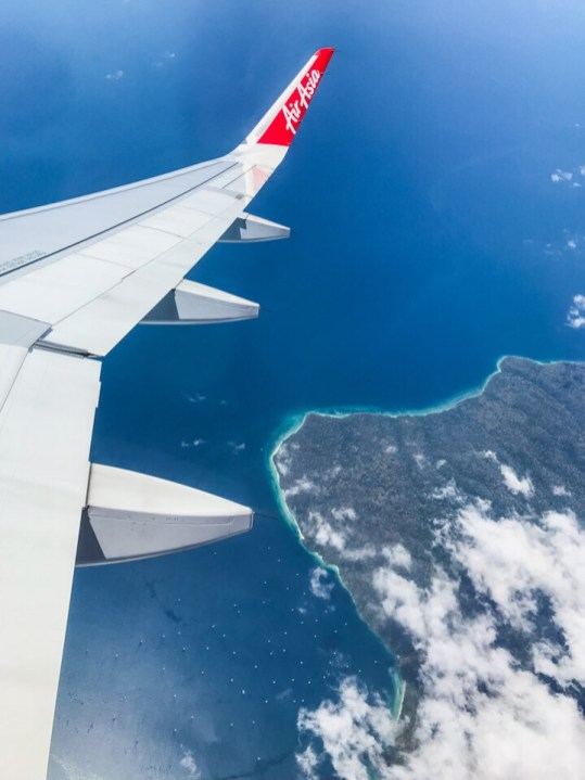 The blue water of Indonesia from the plane traveling from Bali to Bangkok