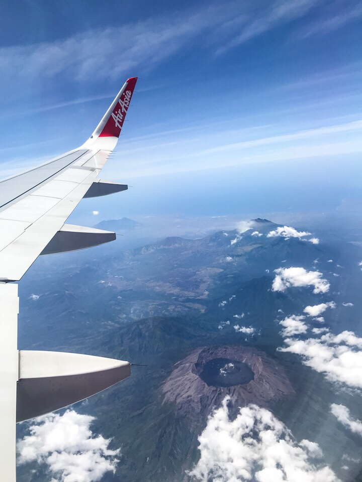 View of volcanoes from the plane window in Indonesia traveling from Bali to Bangkok