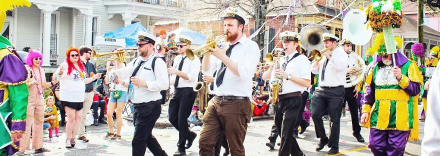 A band marching in a parade during Mardi Gras in New Orleans