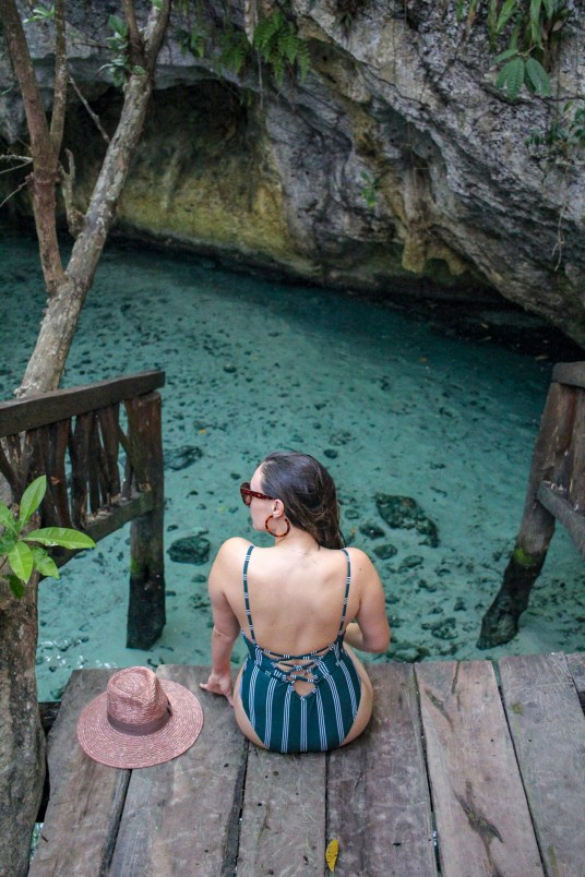 girl sitting admiring the grand cenote