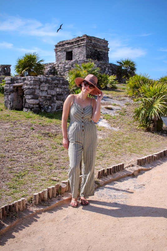 girl standing in front of tulum ruins