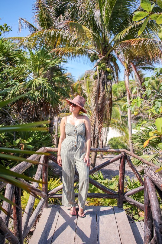 girl in front of the jungle of tulum