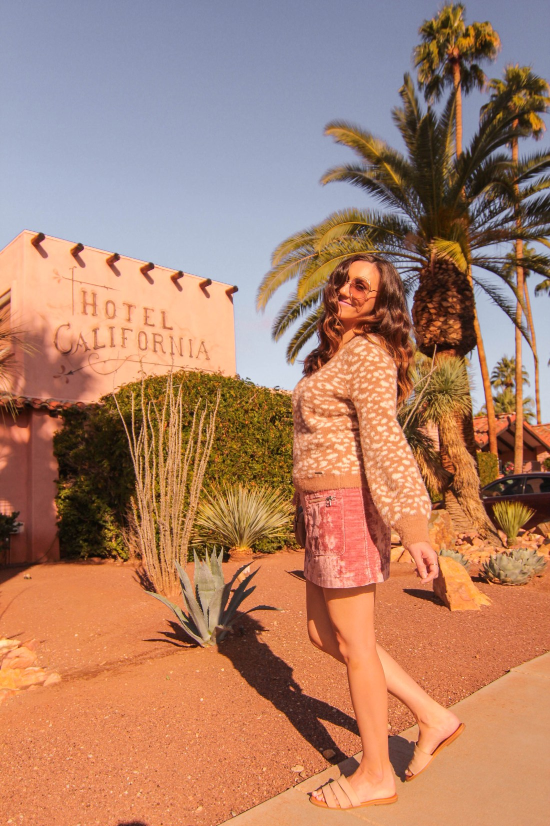girl in front of hotel california palm springs
