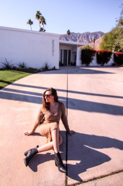 girl in midcentury home driveway