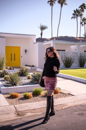 girl in front of modern palm springs home