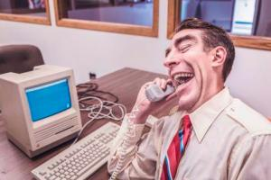 Businessman laughing on phone