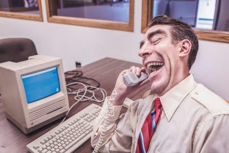 Freelance London copywriter's advice on quoting people in B2B marketing. Shows businessman laughing.