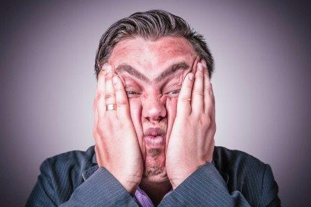 Businessman holding his head in frustration