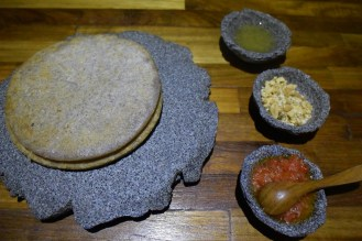 Bread is a roti made from sweet potato and coconut, served with a peanut oil, a sweet peanut mix, and a kind of salsa sambal.
