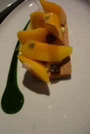 Mango Liquorice Sable - mango and a passion fruit candy served on a sable cracker with liquorice & dill sauce.