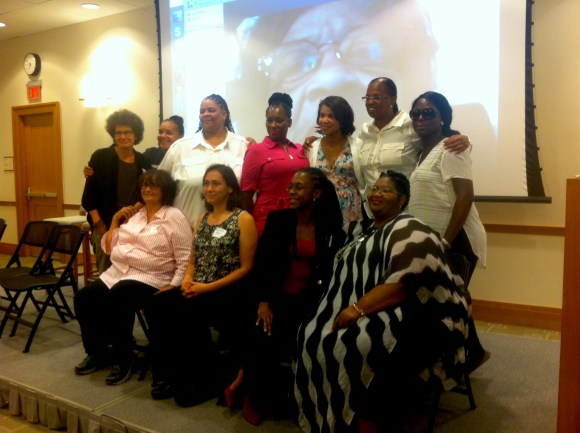 This picture shows the participants of the Real Women Real Voices panel. Top Left: Susan Rosenberg, Andrea James, Justine Moore, Star Patterson, Kemba Smith, Topeka Sam, Lana from Black & Pink. Bottom Left: Beatrice Codianni, Meghann Perry, Lashonia Etheridge, Dorothy Gaines. Grandma Phyllis Hardy is pictured from a skype call on the screen behind the women. photo by etta cetera
