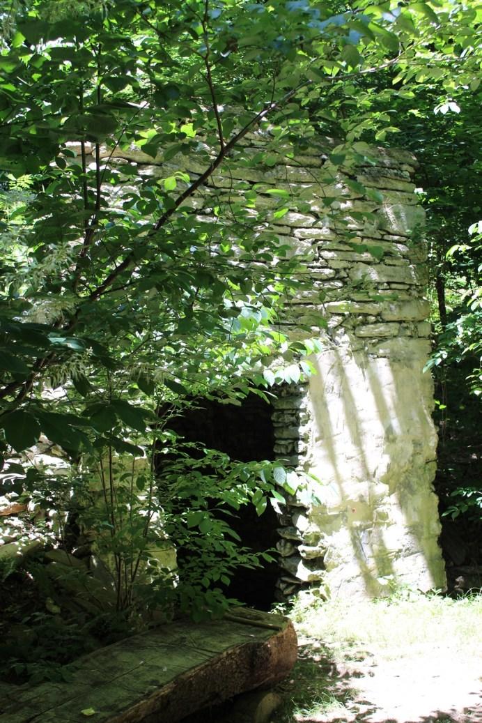 a white stone springhouse