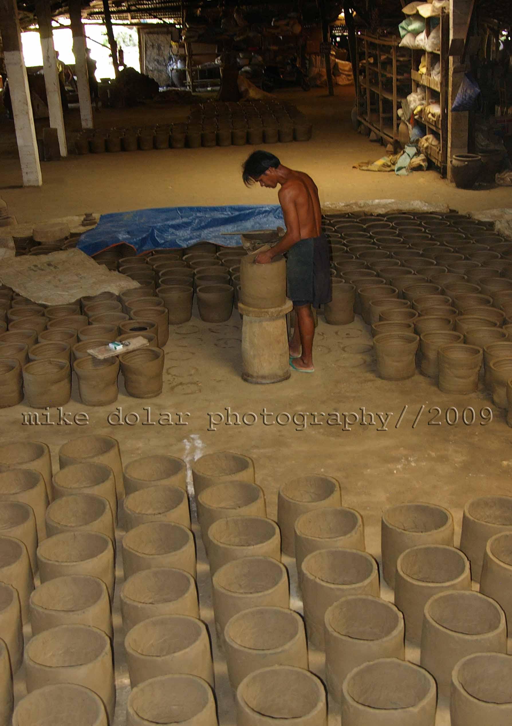 man toiling at burnay factory