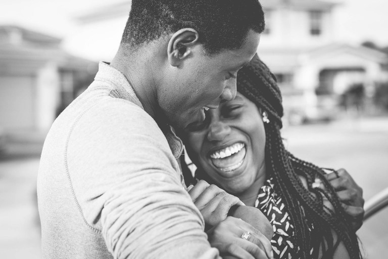two people hugging and laughing