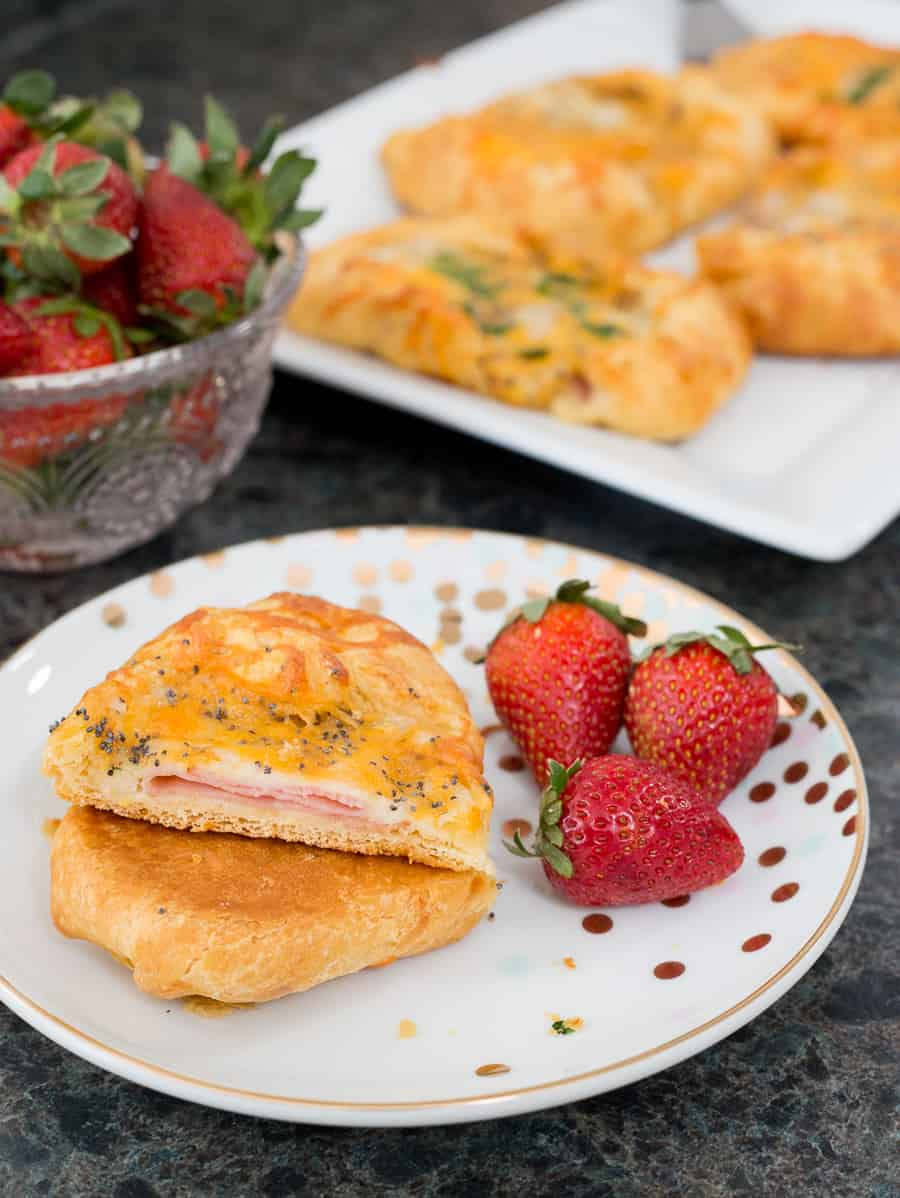 Over Thirty Tasty Brunch Recipes - Perfect for parties, celebrating the holidays, or enjoying a lazy weekend breakfast at home with your family. We've got you covered. Your kids are sure to love these Ham and Cheese Crescent Puffs. The mustard glaze is delicious! *Great list of make-ahead ideas for menu planning.