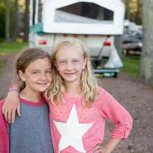 Two girls on a family camping trip