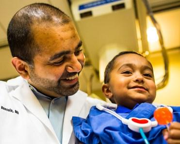 Dr. Waqas Hussain and his son, Humza