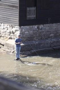 Kid fishing in stream near mill at Wildcat Den