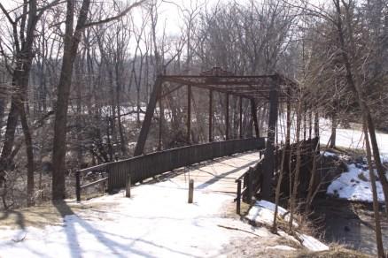 Snow covered bridge at Wildcat Den Park
