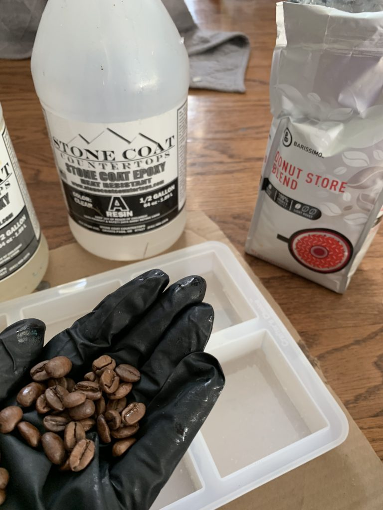 adding coffee beans to epoxy resin coasters