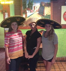 Michelle, the bartender, and myself with proper taco eating hats