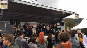 Gavas Beat on stage with audience members at the Pittsburgh Taco Festival