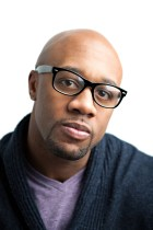 Stylish African American man wearing black framed glasses. Shallow depth of field.