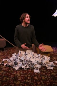 Gary McNair with quite a pile of gambling chits. A Gambler's Guide To Dying at 59E59 Theaters. Photo Bemjamin Cowie.