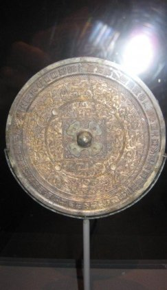 Mirror, Han dynasty (206 B.C.-A.D. 220), Broze, Diam.7 5/16 in. (18.6 cm), Lent by National Museum of China.