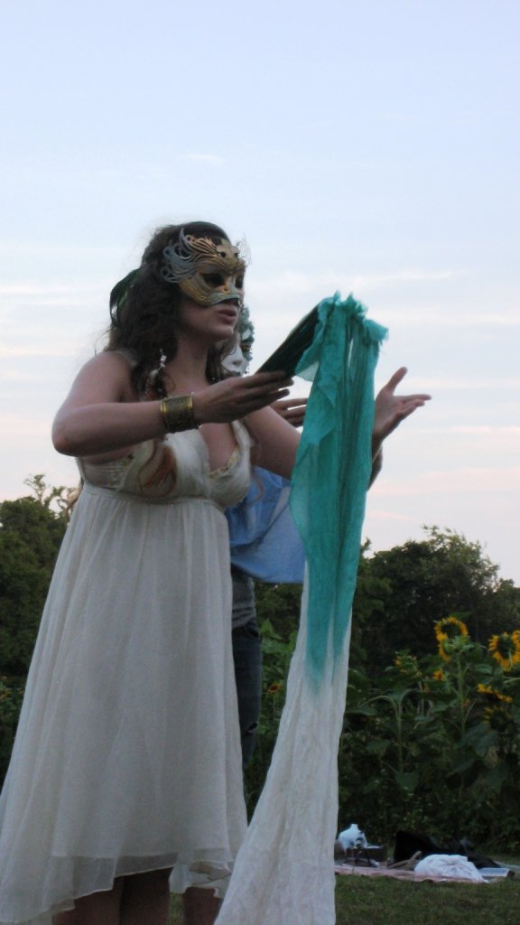 Jessica Giannone asAriel, masked,wields some magic,helped by a maskedSpirit. Photo Robert Ruben