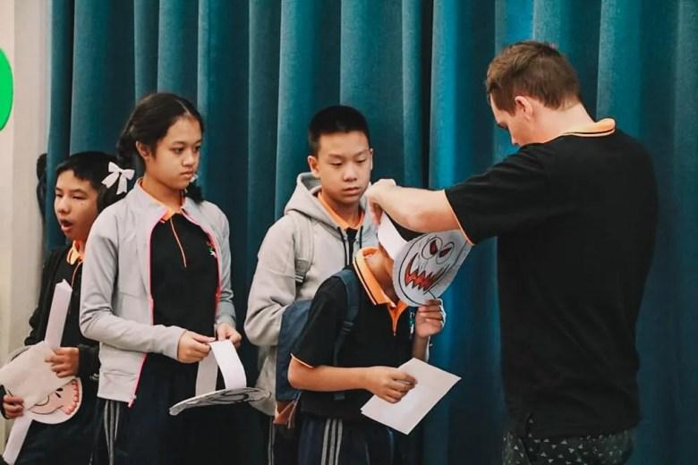 Jon helping his students put on their papar masks