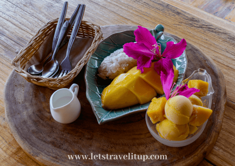 Delicious mango and sticky rice with mango and passion fruit ice cream