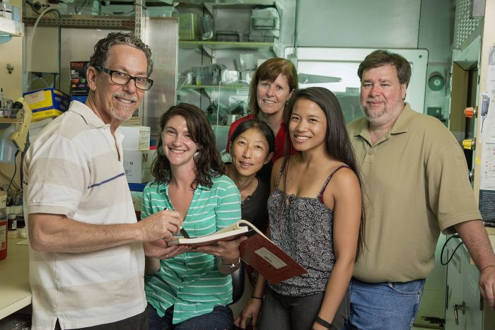 Pancreatic cancer researcher Ron Evans (left) and his research team: Mara Sherman, Ruth Yu, Ann Atkins, Tiffany Tseng, Michael Downes