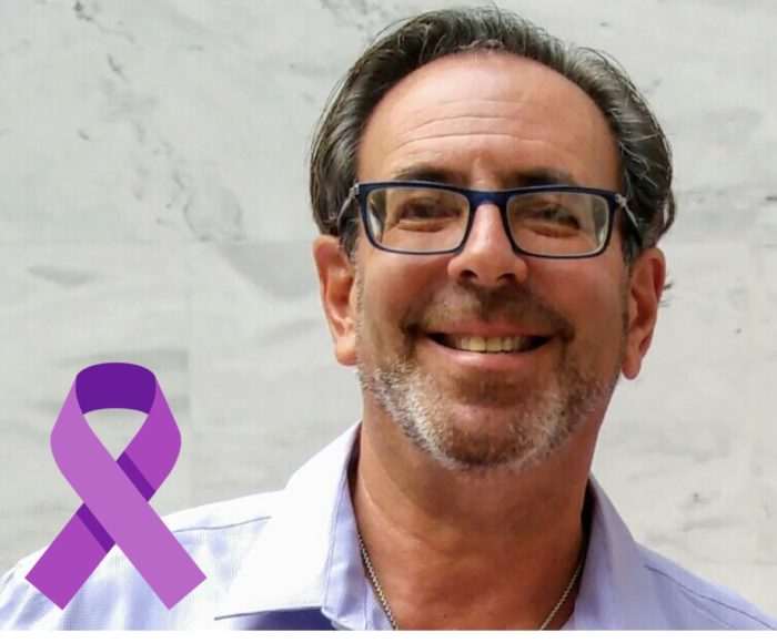 Pancreatic cancer patient Barry Reiter and a purple ribbon