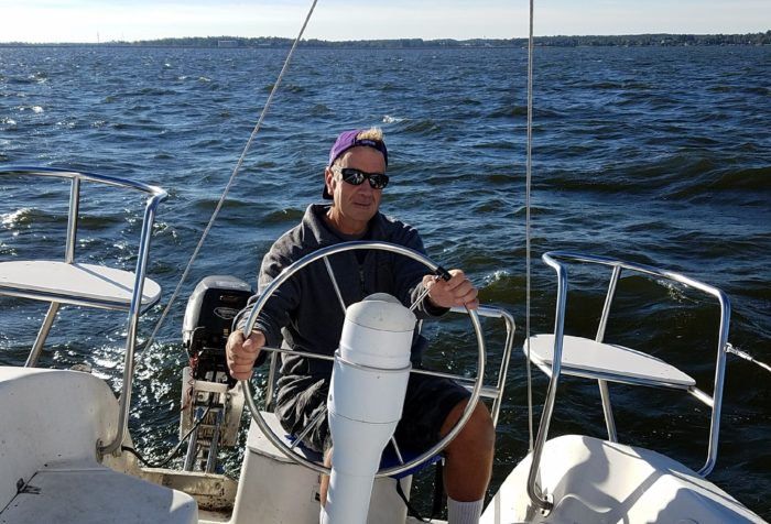 Pancreatic cancer patient Scott Hirshey on his boat on a lake
