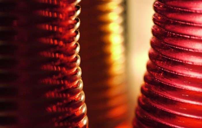 Abstract image of vertical ridged lines of reds and oranges
