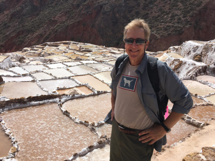 Randall Swan standing next to the Maras Salt Mines near Cuzco, Peru