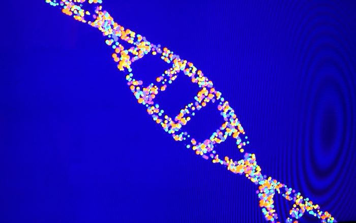 DNA helix made of multicolor dots on a bright blue background