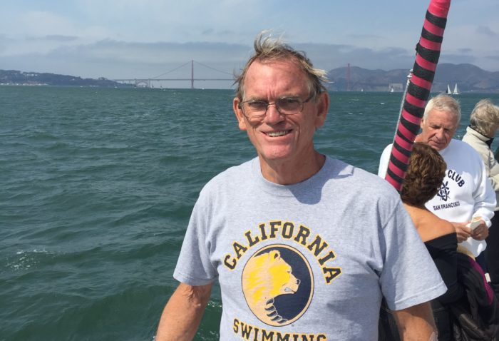Pancreatic cancer survivor Ed Duncan on the water of San Francisco bay, with the Golden Gate Bridge in the background