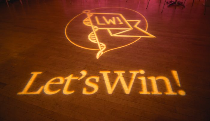 Projection of Let's Win logo on the floor of the Helen Mills Theatre, site of the inaugural benefit.