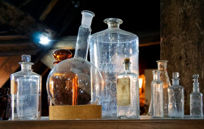 Old glass medicine bottles, in clear and brown colors