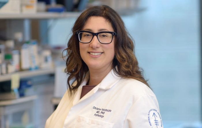 Dr. Christine Iacobuzio-Donahue in her lab, in a white lab coat