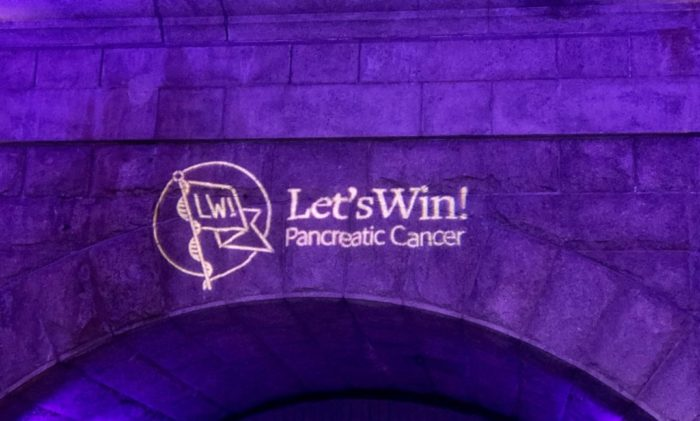 Let's Win logo projected on the arch at Guastavino's