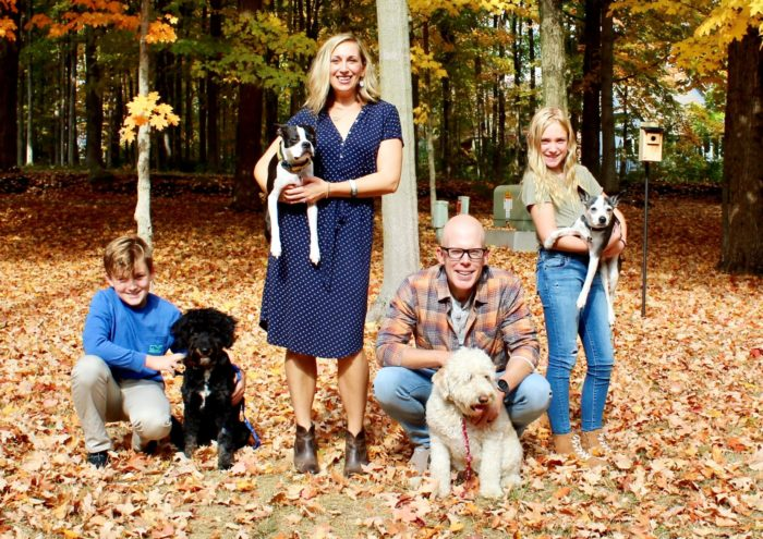 Pancreatic cancer patient Chad Handley, his family and dogs, outdoors with fallend leaves