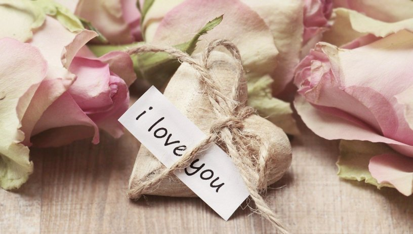 """romantic dried pink roses with string covered heart with hand written note saying, """"I love you"""""""