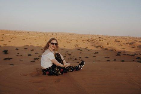 Girl sitting in the desert