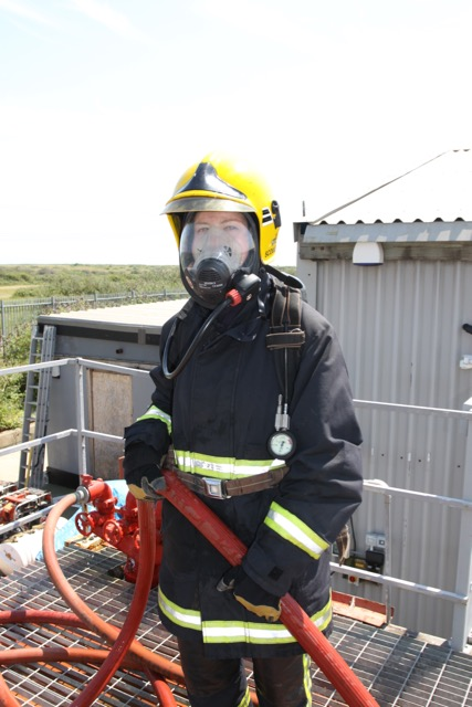 me wearing firefighting gear