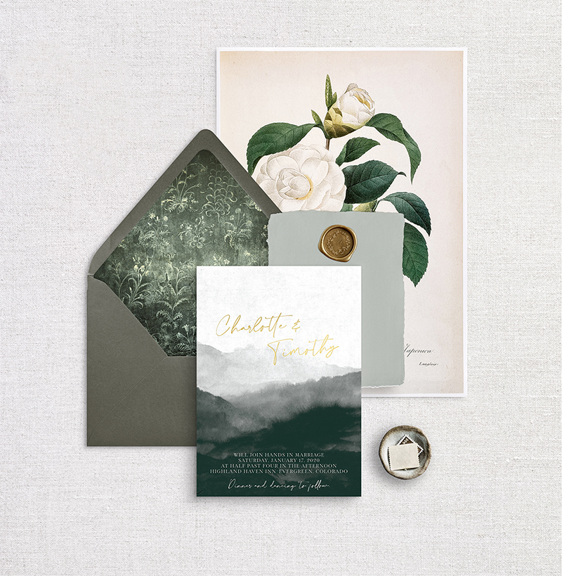 Mountain wedding invitation with beautiful gold foil and artistic details